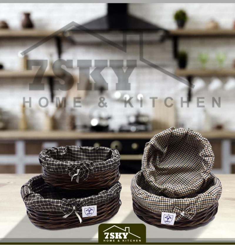 A pair of wicker bread baskets